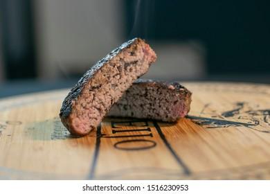 Medium rare grilled burger patty close up
