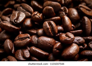 Medium roasted organic coffee beans close up.  Processed in vintage and worm tone color.