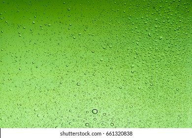Medium sea green water drops abstract background