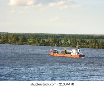 A medium ship going against the river tide, with and island in the background. Parana river, Rosario city, Argentina