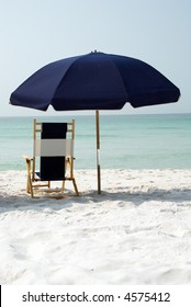 Medium shot of beach umbrella with more white sand in foreground
