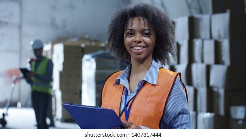 Medium shot of female supervisor in a warehouse