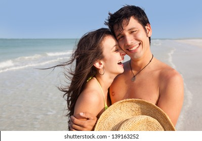 Medium shot of Latin young Man and Woman laughing on Florida Beach