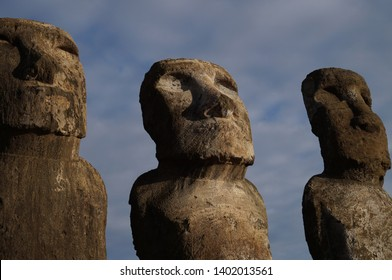 Medium shot of three moais of the Ahu Tongariki series of moais located on Easter Island.
