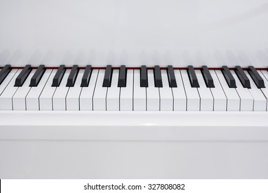 Medium shot of white piano.