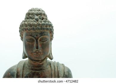 Medium shot of wooden buddha statue over white background