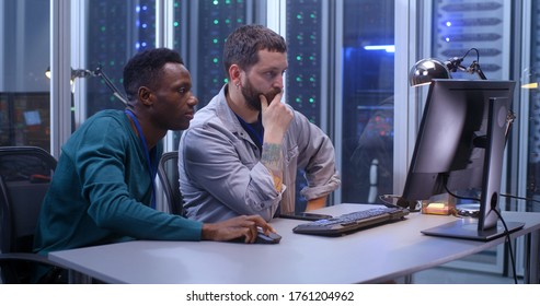Medium shot of young programmers working in a data center together