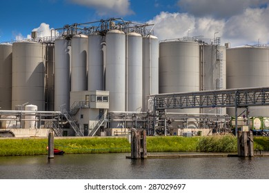 Medium sized strategic industrial Tank Storage area with docking facility in a harbor in the Netherlands