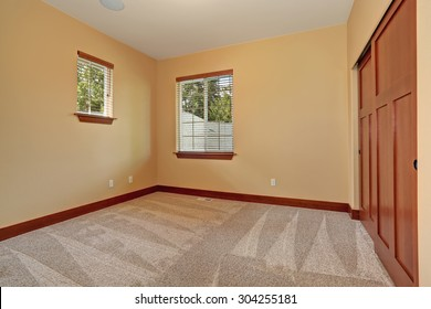 Medium sized unfurnished room with beige interior paint.