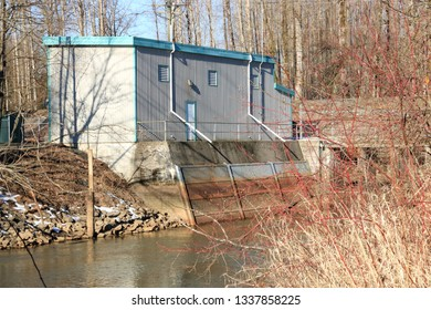 Medium view of a water pumping station set beside a creek where fresh water is drawn and distributed throughout the community.