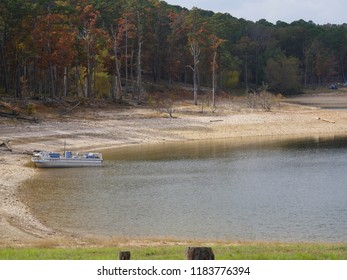 Medium wide shot of Broken Bow Lake at the Beavers Bend State Park in the southeastern part of Oklahoma in autumn