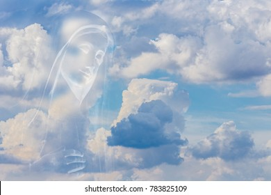 The Medjugorje Blessed Virgin Mary on white clouds on bright blue sky