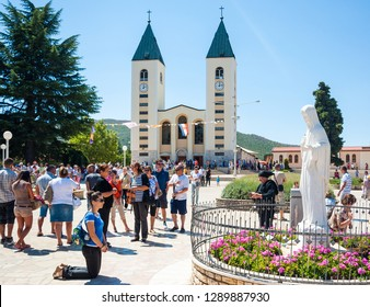 Medjugorje / Bosnia and Hercegovina - August 12 2012: Person praying in front on saint mary in Medjugorje, Bosnia and Hercegovina. People in Medjugorje, Bosnia and Hercegovina.