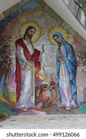 MEDJUGORJE, BOSNIA AND HERZEGOVINA, 2016/06/05. Mosaic of the wedding of Cana of Galilee where Jesus Christ worked his first miracle on the intercession of His Mother Mary. The second Luminous mystery