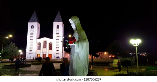 Medjugorje, Bosnia and Herzegovina - April, 2018. Statue of Virgin Mary and Saint James Church at night, Medjugorje, Bosnia and Herzegovina