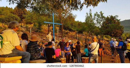 Medjugorje, Bosnia and Herzegovina - April, 2018. Blue cross at Podbrdo hill at sunset, Medjugorje, Bosnia and Herzegovina