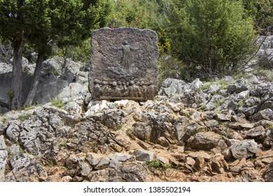 MEDJUGORJE, BOSNIA AND HERZEGOVINA - APRIL 21: Bronze relief on Apparition hill Podbrdo overlooking the village of Medjugorje in Bosnia and Herzegovina