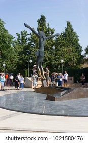 MEDJUGORJE, BOSNIA AND HERZEGOVINA - AUGUST 16 2017: Statue of Risen Christ in Medjugorje, with pilgrims around