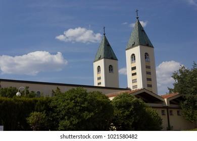 MEDJUGORJE - BOSNIA AND HERZEGOVINA -AUGUST 16 2017: Saint James belfries in Medjugorje in summer season, nobody around