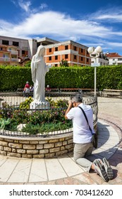 MEDJUGORJE, BOSNIA AND HERZEGOVINA - AUGUST 25, 2017: Piligrim prayer in Medjugorje - popular site of Catholic pilgrimage in Bosnia and Herzegovina
