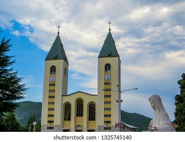 MEDJUGORJE, BOSNIA AND HERZEGOVINA - AUGUST 7, 2015: View of the Virgin Mary statue and the Saint James Church.