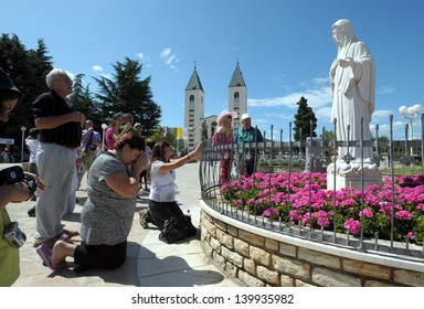 MEDJUGORJE, BOSNIA AND HERZEGOVINA - AUGUST 8: Unidentified pilgrims visit st. James Church on August 8, 2009 in Medjugorje, Bosnia and Herzegovina. It is known for reported apparitions of Virgin Mary