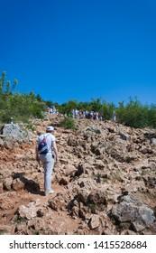 Medjugorje, Bosnia and Herzegovina - July 6 2012: Pilgrims visit Apparition Hill in Medjugorje, Bosnia and Herzegovina.