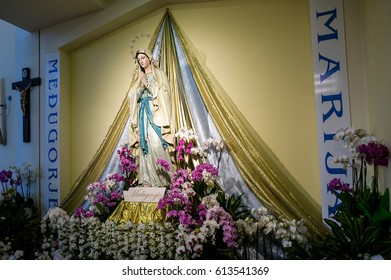 Medjugorje, Bosnia and Herzegovina - June 17, 2012: Inside Saint James church, statue of Holy Mary - Our Lady of Medjugorje, this is the place where it is believed that Blessed Virgin Marry appeared.