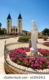 Medjugorje, Bosnia and Herzegovina - June 17, 2012: Saint James church and statue of Holy Mary - Our Lady of Medjugorje, this is the place where it is believed that Blessed Virgin Marry appeared.