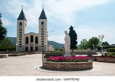 MEDJUGORJE, BOSNIA AND HERZEGOVINA, MAY 12, 2010 – Pilgrimage church and Virgin Mary statue in Medjugorje