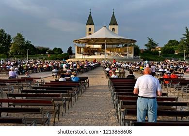Medjugorje, Bosnia and Herzegovina - May 22 2009: Pilgrims attend to a mass