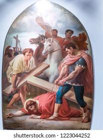 Medjugorje, Bosnia and Herzegovina - November 3, 2018: paintings of Via Crucis: IX. Jesus Falls for the Third Time