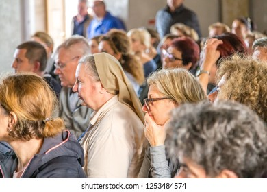 Medjugorje, Bosnia and Herzegovina - November 3, 2018: people praying in church and looking at the altar