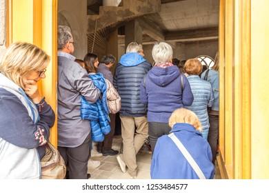 Medjugorje, Bosnia and Herzegovina - November 3, 2018: people enter the church and pray