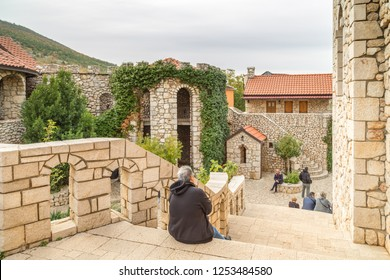 Medjugorje, Bosnia and Herzegovina - November 3, 2018: pilgrims sit and walk the streets of the town