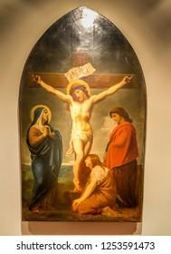 Medjugorje, Bosnia and Herzegovina - November 3, 2018: painting of Via Crucis: TWELFTH STATION, Jesus dies on the cross