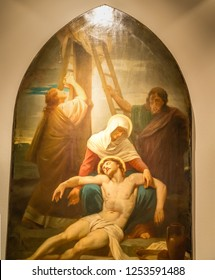Medjugorje, Bosnia and Herzegovina - November 3, 2018: painting of Via Crucis: THIRTEENTH STATION, Jesus is taken down from the cross and given to his mother