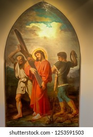 Medjugorje, Bosnia and Herzegovina - November 3, 2018: painting of Via Crucis: FIFTH STATION, Jesus is helped to carry his cross by Simon of Cyrene
