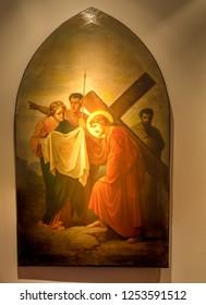 Medjugorje, Bosnia and Herzegovina - November 3, 2018: painting of Via Crucis: SIXTH STATION, Veronica wipes the face of Jesus
