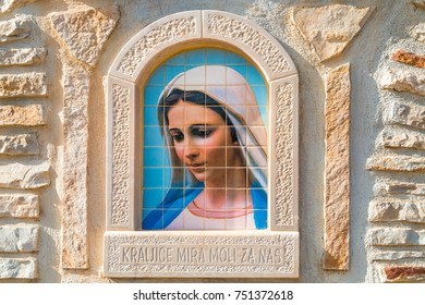 MEDJUGORJE, BOSNIA AND HERZEGOVINA - NOVEMBER 5:  painting of Our Lady of Medjugorje, a popular destination for pilgrims on November 5, 2017. Croatian sentence meaning Queen of Peace pray for us