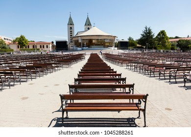 Medjugorje, Bosnia and Herzegowina, July 15 2017: Saint James Church with wooden benches in Medjugorje is a popular destination for pilgrims