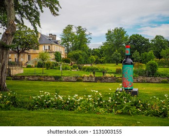 Medoc, Bordeaux / France - May 18 2014: Chateau Kirwan gardens and chateau in the Medoc