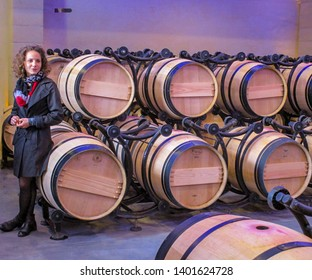Medoc / France - Sept. 4, 2017: Bordeaux Wine Guide Explains Fermentation Process in Medoc Wine Cave