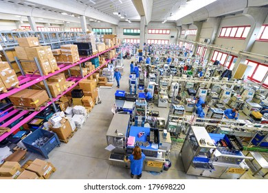 MEDOLLA, ITALY-OCTOBER 17, 2012: Factory lines workers assembling medical devices at the Gambro factory, Italian division.