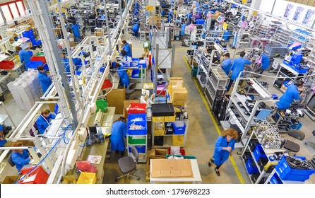 MEDOLLA, ITALY-OCTOBER 17, 2012: Top view of factory lines workers, assembling medical devices at the Gambro factory, Italian division.