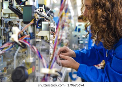 MEDOLLA, ITALY-OCTOBER 17, 2012: Woman assembling a medical device on a factory line, at the Gambro factory, Italian division.