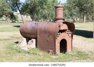MEDORA,NORTH DAKOTA USA,23 JULY 2018. Old steam engine at the slaughterhouse ruins in Chimney Park at Chateau De Mores State Historic Site, Medora, North Dakota, USA