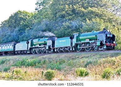 MEDSTEAD, UK - SEPTEMBER 9: Ex Southern locomotive 925 Cheltenham, leads sister Southern loco 825 Lord Nelson towards Ropley station at the Mid Hants autumn steam gala on September 9, 2012 at Medstead