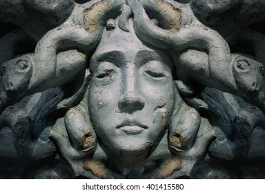 Medusa goddess face statue. Old dusty and cracked face statue of greek goddess Medusa.