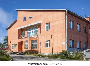 Medvezhegorsk, Russia - Aug 26, 2012: In a small brick building in Medvezhyegorsk located office of Karelian Power Sales Company